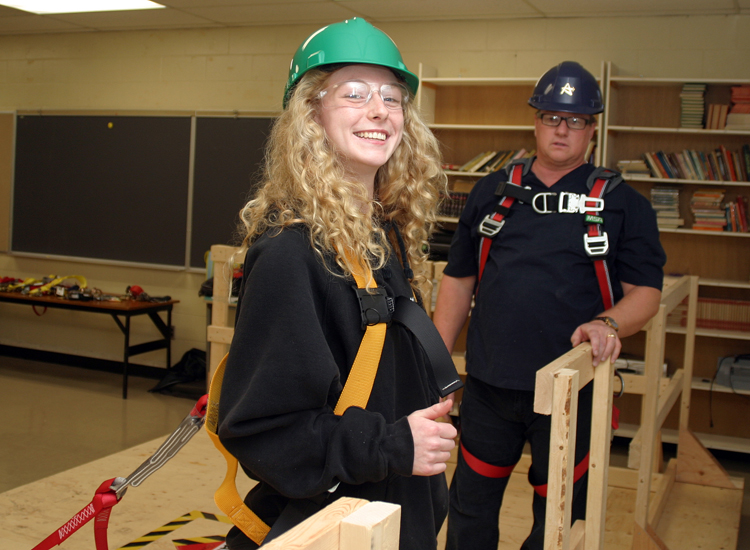 Valour School Grade 11 student Madison Brough is all smiles after passing her Working at Heights certification training under the eye of instructor RCDSB Health and Safety Officer Shane Halliday.